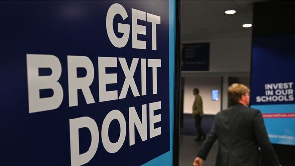 Conservative Party branding encouraging them to Get Brexit Done and Invest in our Schools is seen at the Manchester Central convention complex in Manchester, north-west England on September 29, 2019, on the first day of the annual Conservative Party conference. - Embattled British Prime Minister Boris Johnson gathered his Conservative party Sunday for what could be its final conference before an election, promising to get Brexit done. - Sputnik International