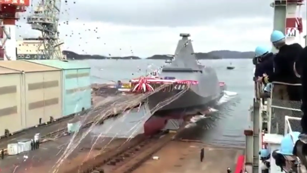 Amid a flurry of streamers and balloons, Japan's first 30FFM-class frigate is launched at the Mitsui shipyard in Tamano, Okayama Prefecture, on November 19, 2020 - Sputnik International