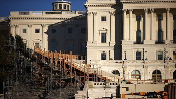 The inaugural platform is seen under construction in front of the U.S. Capitol building in Washington, U.S. November 16, 2020. - Sputnik International