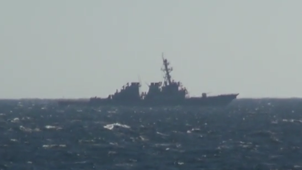 The US Navy destroyer USS John C. McCain, filmed from the deck of the Russian frigate Admiral Vinogradov as the McCain performed a freedom of navigation operation in Russia's Peter the Great Gulf on November 24, 2020 - Sputnik International