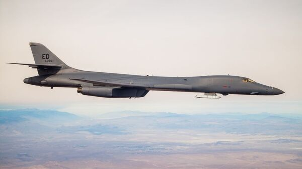 A B-1B Lancer with a Joint Air-to-Surface Standoff Missile (JASSM) flies in the skies above Edwards Air Force Base, California, Nov. 20. The flight was a demonstration of the B-1B's external weapons carriage capabilities. - Sputnik International