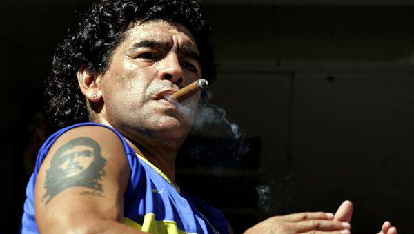 FILE PHOTO: Former Argentine soccer star Diego Maradona smokes a cigar before the start of the Argentine First Division soccer match between Boca Juniors and San Lorenzo de Almagro at La Bombonera stadium in Buenos Aires February 19, 2006 - Sputnik International