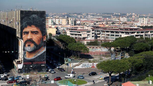 A general view shows a mural by artist Jorit depicting late Argentine soccer legend Diego Maradona, in Naples, Italy November 26, 2020 - Sputnik International
