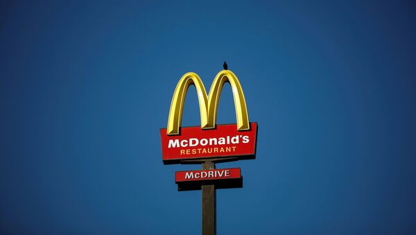 The McDonald's company logo stands on a sign outside a restaurant in Bretigny-sur-Orge, near Paris, France, July 30, 2020. - Sputnik International
