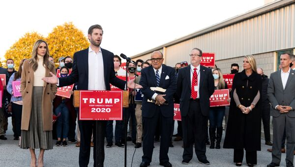 Eric Trump, son of US President Donald Trump, speaks while flanked by his wife Lara, former New York City Mayor Rudy Giuliani, Trump campaign ballot counting observer Jeremy Mercer, and former Florida Attorney General Pam Bondi during a news conference at Atlantic Aviation PHL private air terminal in Philadelphia, Pennsylvania, US, 4 November 2020. - Sputnik International