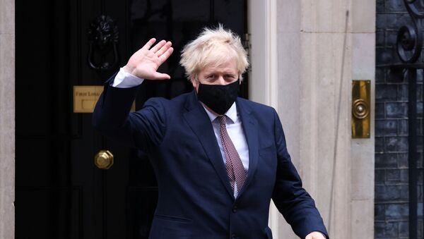 Britain's Prime Minister Boris Johnson seen in public for the first time since his self-isolation ended, leaves Downing Street during the coronavirus disease (COVID-19) outbreak in London, Britain, November 26, 2020. - Sputnik International