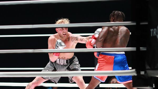 Jake Paul (grey trunks) fights Nate Robinson (red and blue trunks) during a cruiserweight boxing bout at the Staples Center - Sputnik International