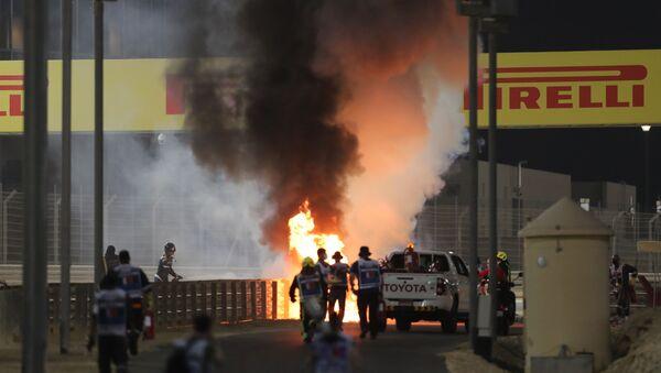 Bahrain International Circuit, Sakhir, Bahrain - November 29, 2020 Flames seen from the crash scene after Haas' Romain Grosjean crashed out at the start of the race - Sputnik International
