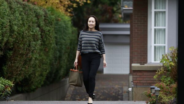 Huawei chief financial officer Meng Wanzhou, monitored at all times under house arrest, heads to a Canadian court to fight an extradition battle to the US after being charged on allegations of banking fraud - Sputnik International