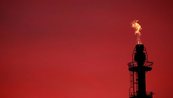 Flames come out of a chimney at the French oil giant Total Refinery during sunset in Donges, France, November 30, 2020. - Sputnik International
