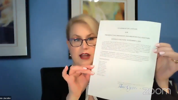 Screenshot from the video showing the head of Wisconsin Election Commission Ann Jacobs signing the official state determination of the results of the 3 November, 2020 election and the canvass - Sputnik International