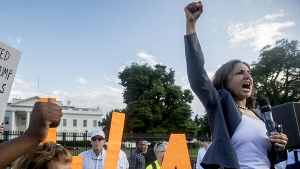 Center for American Progress President Neera Tanden speaks at a protest outside the White House, Tuesday, July 17, 2018, in Washington - Sputnik International