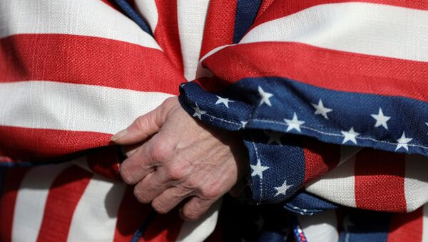 FILE PHOTO: A supporter of U.S. President Donald Trump wearing the colors of the U.S. flag participates in a Stop the Steal protest after the 2020 U.S. presidential election was called for Democratic candidate Joe Biden, in Lansing, Michigan, U.S. November 14, 2020.  - Sputnik International