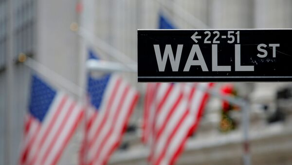 A street sign for Wall Street is seen outside the New York Stock Exchange (NYSE) in Manhattan, New York City, U.S. December 28, 2016. - Sputnik International
