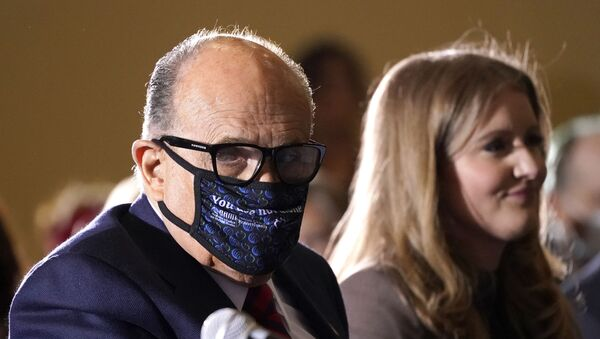Former Mayor of New York Rudy Giuliani, a lawyer for President Donald Trump, wears a face mask to protect against COVID-19 after speaking at a hearing of the Pennsylvania State Senate Majority Policy Committee, Wednesday, Nov. 25, 2020, in Gettysburg, Pa. - Sputnik International