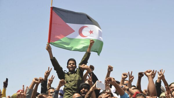 In this Friday, June 3, 2016 file photo, members of the Polisario Front, the organization disputing sovereignty over Western Sahara with Morocco, mourn their leader, Mohamed Abdelaziz, during his funerals held in the Rabouni refugees camp, south western Algeria. - Sputnik International