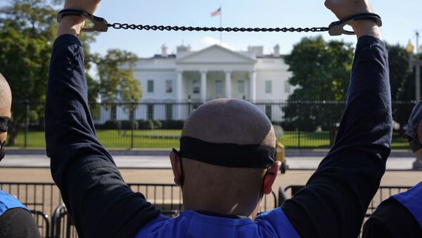 A member of the Uyghur American Association rallies in front of the White House, Thursday, Oct. 1, 2020, after marching from Capitol Hill in Washington, in support of the Uyghur Forced Labor Prevention Act which has passed the House and now will go on to the Senate. - Sputnik International