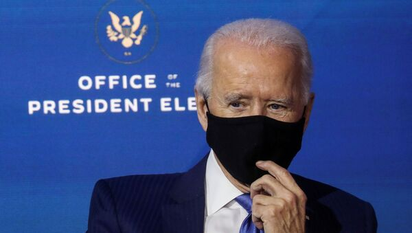 U.S. President-elect Joe Biden listens after announcing nominees and appointees to serve on his economic policy team at his transition headquarters in Wilmington, Delaware, U.S., December 1, 2020 - Sputnik International