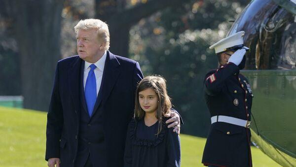 President Donald Trump walks with his granddaughter Arabella Kushner on the South Lawn of the White House in Washington, Sunday, Nov. 29, 2020 - Sputnik International