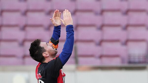 November 29, 2020 FC Barcelona's Lionel Messi celebrates scoring their fourth goal wearing a Newell's Old Boys shirt in reference to former player Diego Maradona - Sputnik International