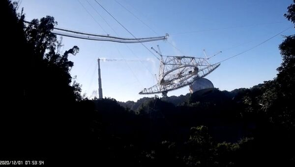 Screenshot shows the exact moment in which the cables attached to the Arecibo Observatory's radio telescope snap and send the structure crashing down to the dish platform. - Sputnik International