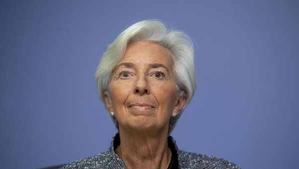 In this Thursday, March 12, 2020 file photo the President of European Central Bank Christine Lagarde looks up prior to a press conference following a meeting of the ECB governing council in Frankfurt, Germany. - Sputnik International