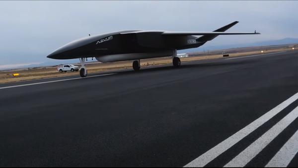 A screenshot from the December 3 video presentation of RavnX drone made by Aevum company standing in a hangar. - Sputnik International