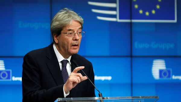 European Commissioner for Economy Paolo Gentiloni speaks during an online news conference following a Eurogroup video conference meeting at the European Council headquarters in Brussels, Belgium November 30, 2020. - Sputnik International