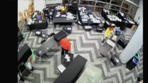 Screenshot from the video allegedly showing election staffers in Fulton County, Atlanta, Georgia, staying behind and pulling out boxes of extra ballots - Sputnik International
