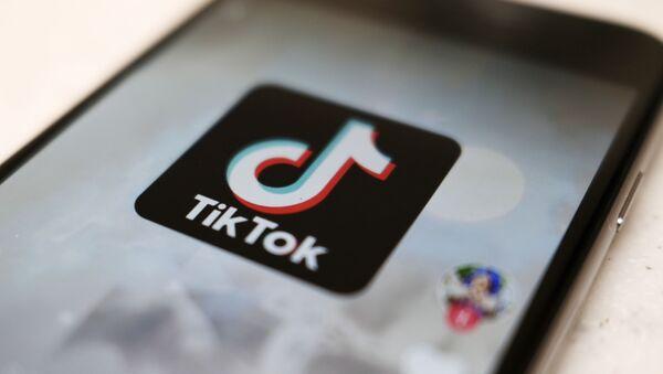 A logo of a smartphone app TikTok is seen on a user post on a smartphone screen Monday, Sept. 28, 2020, in Tokyo - Sputnik International