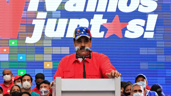 Handout picture released by the Venezuelan Presidency showing Venezuela's President Nicolas Maduro speaking during a campaign rally in Caracas, on December 3, 2020, ahead of the weekend's parliamentary election - Sputnik International