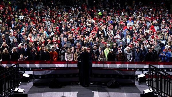 People listen as U.S. President Donald Trump speaks during a campaign rally for Republican U.S. senators David Perdue and Kelly Loeffler, ahead of their January runoff elections to determine control of the U.S. Senate, in Valdosta, Georgia, U.S., December 5, 2020. REUTERS/Jonathan Ernst? - Sputnik International