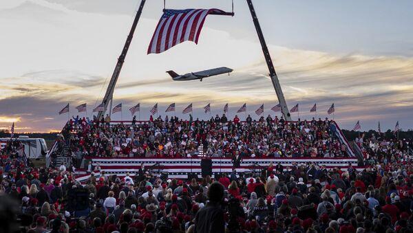 A jet takes off from Valdosta Regional Airport before the start of a rally featuring President Donald Trump for U.S. Senators Kelly Loeffler, R-Ga., and David Perdue, R-Ga., Saturday, Dec. 5, 2020 in Valdosta, Ga - Sputnik International