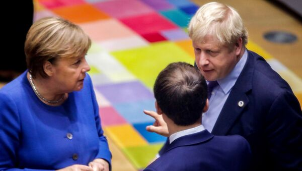 British Prime Minister Boris Johnson (R), French President Emmanuel Macron (C) and German Chancellor Angela Merkel (L) speak upon their arrival for a round table meeting as part of a European Union summit at European Union Headquarters in Brussels on October 17, 2019. - Sputnik International