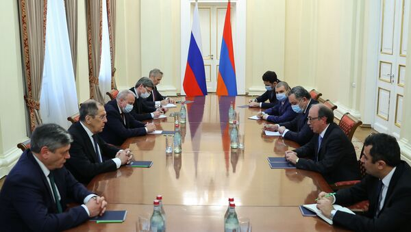 In this handout photo released by Russian Foreign Ministry, Russian Foreign Minister Sergei Lavrov attends a meeting with his Armenian counterpart Ara Aivazian, in Yerevan, Armenia - Sputnik International