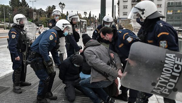 Police arrest demonstrators in Athens during an attempt to demonstrate in front of the Greek Parliament in Athens on December 4, 2020 to commemorate the killing of Alexis Grigoropoulos by the police, which sparked month of rioting across the country in 2008 - Sputnik International