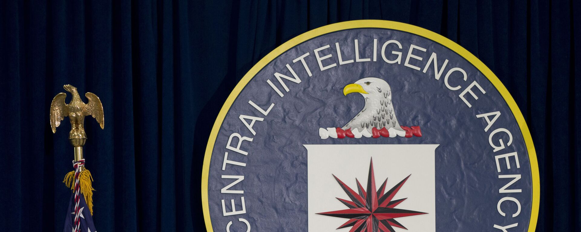 This April 13, 2016 file photo shows the seal of the Central Intelligence Agency at CIA headquarters in Langley, Va. James Pars, a CIA intelligence officer, says his career was derailed after he complained that his boss at a base in a conflict zone repeatedly ordered personnel to travel through dangerous areas on non-essential trips to shop and buy food - Sputnik International, 1920, 30.07.2021