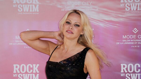 US actress Pamela Anderson poses before attending the Rock My Swim by Mode City Paris fashion show in Paris on July 8, 2017 - Sputnik International