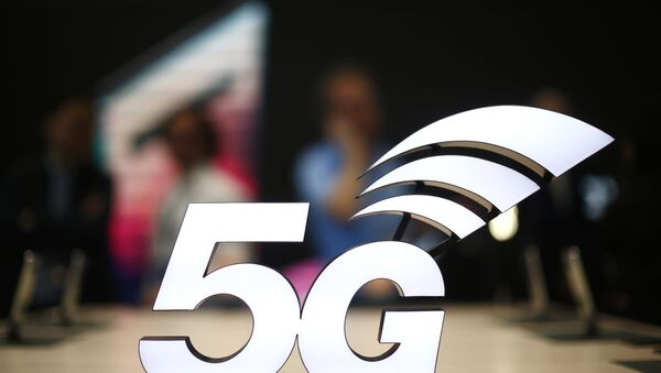FILE - This Feb. 25, 2019 file photo shows a banner of the 5G network is displayed during the Mobile World Congress wireless show, in Barcelona, Spain.  - Sputnik International