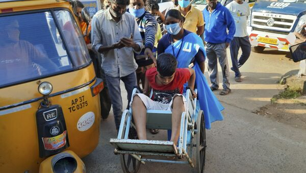 A young patient is brought in a wheelchair to the district government hospital in Eluru, Andhra Pradesh state, India, Sunday, Dec.6, 2020.  - Sputnik International