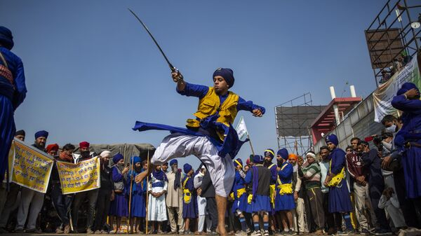 A nihang or a Sikh warrior displays his Sikh martial art skills during a nationwide shutdown called by thousands of Indian farmers protesting new agriculture laws, at the Delhi-Haryana state border, India, Tuesday, Dec. 8, 2020 - Sputnik International