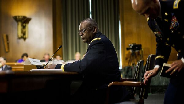 US Central Command Commander Gen. Lloyd Austin III, center seated, looks back to his military aide while testifying on Capitol Hill in Washington, Wednesday, Sept. 16, 2015, before the Senate Armed Services Committee hearing on 'US military operations to counter the Islamic State in Iraq'. - Sputnik International