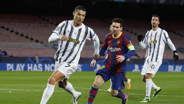 Soccer Football - Champions League - Group G - FC Barcelona v Juventus - Camp Nou, Barcelona, Spain - December 8, 2020 FC Barcelona's Lionel Messi in action with Juventus' Cristiano Ronaldo - Sputnik International