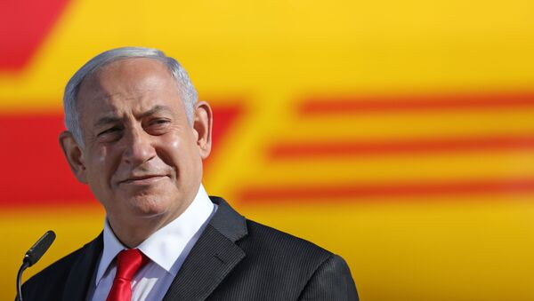 Israeli Prime Minister Benjamin Netanyahu attends a ceremony to mark the arrival of a plane of the international courier company DHL, carrying over 100,000 of doses of the first batch of Pfizer vaccines which landed at Ben Gurion Airport near Tel Aviv, on December 9, 2020.  - Sputnik International