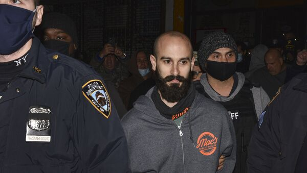 Mac's Public House co-owner Danny Presti is taken away in handcuffs after being arrested by New York City sheriff's deputies, Tuesday, Dec. 1, 2020, in the Staten Island borough of New York - Sputnik International