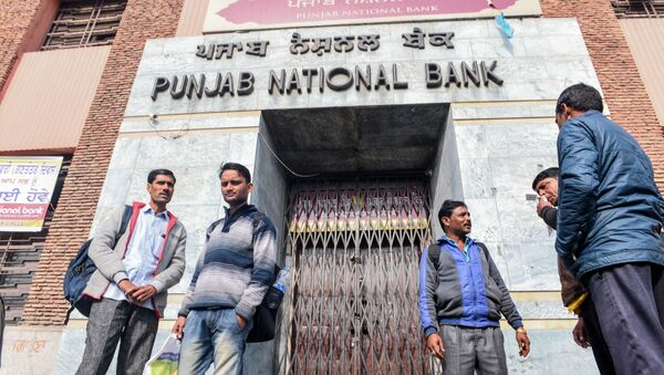 People look on as they stand in front of a closed outlet of Punjab National Bank during a nationwide bank strike in Amritsar on January 31, 2020 - Sputnik International