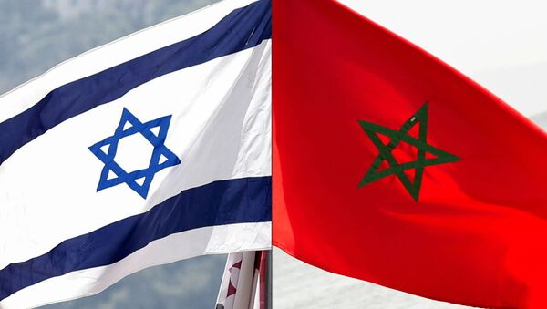 This combination of file pictures created on December 10, 2020 shows a Moroccan flag off the coasts of the city of Cayenne on March 21, 2012 and an Israeli national flag on September 23, 2020 - Sputnik International