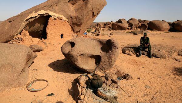 FILE PHOTO: A Polisario fighter sits on a rock at a forward base on the outskirts of Tifariti, Western Sahara, September 9, 2016 - Sputnik International