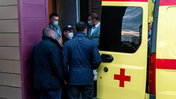 Medics load Alexei Navalny in an ambulance at Omsk Emergency Hospital No 1 where Navalny was admitted after he fell ill in what his spokeswoman said was a suspected poisoning in Omsk on August 22, 2020. - - Sputnik International