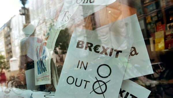 (FILES) In this file photo taken on June 24, 2016 a poster featuring a Brexit vote ballot with out tagged is on display at a book shop window in Berlin.  - Sputnik International